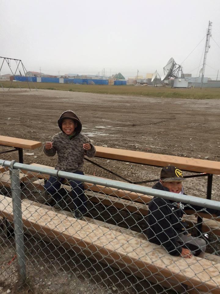 soccer-field-preparation-kids-waiting