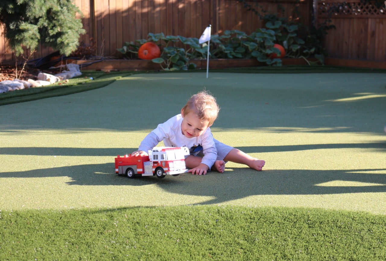 baby on synthetic turf