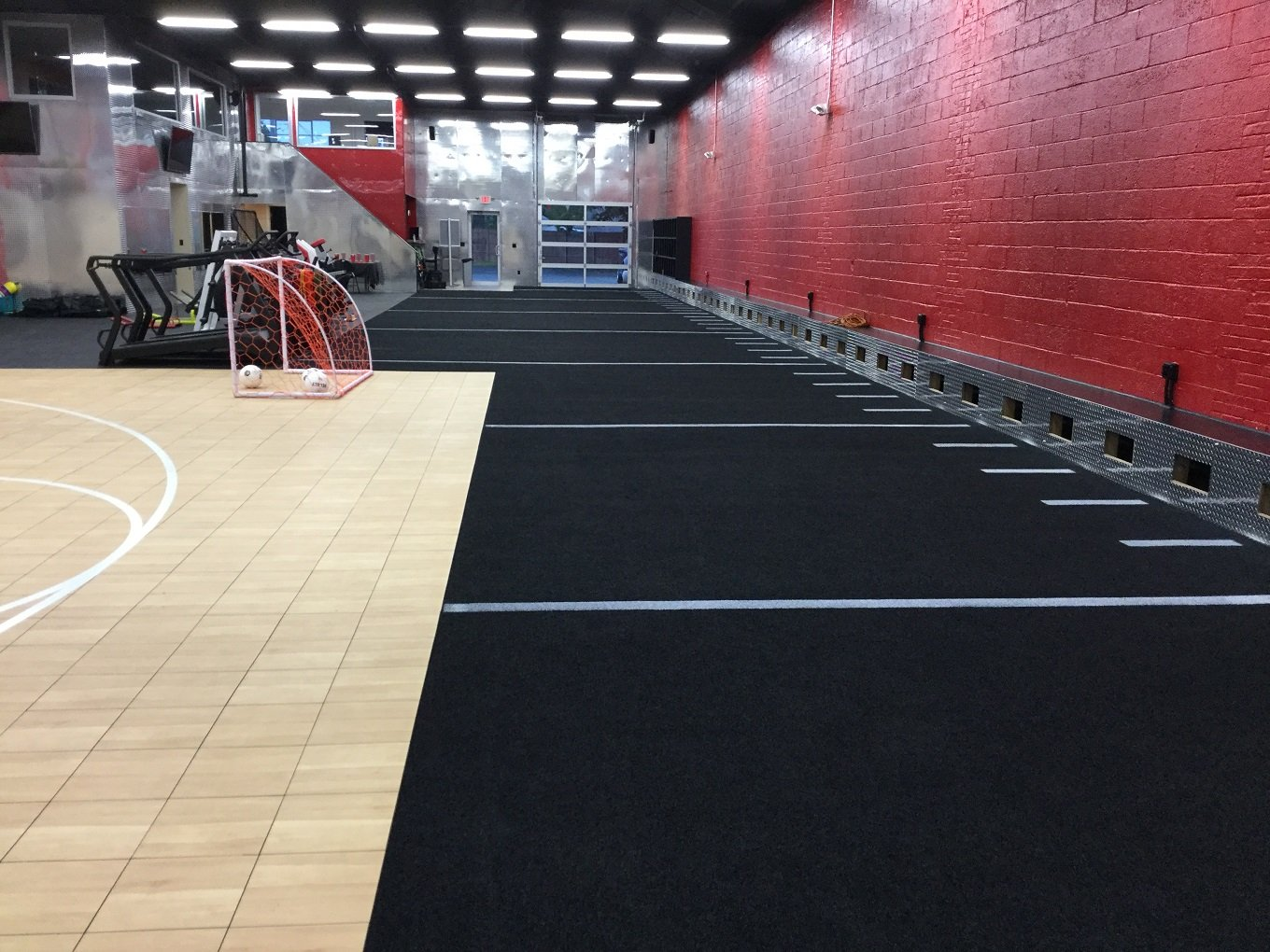 artificial turf dealer STI client red and black gym black artificial turf